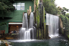 Restaurant with waterfall. A chinese restaurant with waterfall outside Stock Image