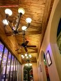 Restaurant,Wooden ceiling,Hanging lamps. At night stock photos