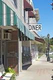 Restaurant-Zeichen und im Stadtzentrum gelegene Front Lizenzfreies Stockbild