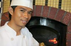 Restaurante de la pizza de los cocineros Imágenes de archivo libres de regalías