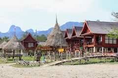 Restaurants on the banks of the Mekong River in Vang Vieng. Bamboo huts royalty free stock photo