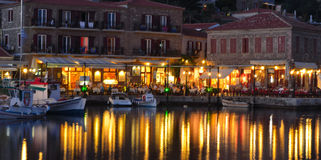 Restaurants and bars around the harbour in Molyvos. Molyvos, Levos, Greece - June 12, 2014: Restaurants and bars around the harbour in Molyvos early evening royalty free stock photography