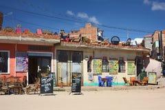 Restaurants in Copacabana, Bolivia. COPACABANA, BOLIVIA - OCTOBER 19, 2014: The restaurants Cuzco Rumi and Winay Marka on the corner of the avenues 6 de Agosto Stock Photos