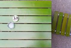 Restaurants garden. Green wooden chair and table in a restaurants garden Stock Photography