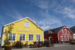 Restaurants in the harbor. Iceland. Siglufjordur. Outdoor summer cafe tables and restaurants at Iceland town Stock Image