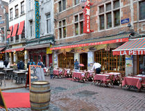 Restaurants in historical center of Brussels. BRUSSELS, BELGIUM-OCTOBER 26, 2014: Restaurants in historical center of Brussels preparing to accept first visitors royalty free stock photos