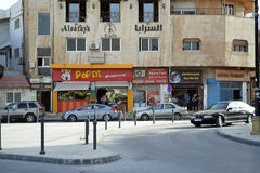 Restaurants in Madaba. Madaba, Jordan - May 27, 2015: Local businesses going on with daily life, deep inside the heart of the city royalty free stock photos