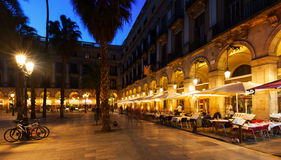 Restaurants at Placa Reial in winter evening. Barcelona Royalty Free Stock Photography