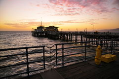 Restaurants on Santa Monica Pier in sunset. Restaurants on the far end of Santa Monica Pier at dusk Royalty Free Stock Photo