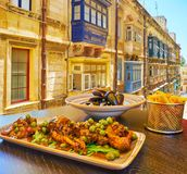Rabbit stew in Valletta, Malta. The restaurants of Strait street are best place to enjoy the famous rabbit stew, french fries, mussels and other traditional Royalty Free Stock Photo