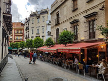 Restaurants in a street in Seville Royalty Free Stock Photos