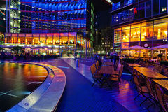 Restaurants under the dome of the Sony Center in Berlin. Night view of restaurants at the bottom of office tower under the dome of the famous Sony Center in Stock Photos