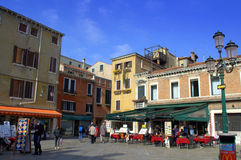 Restaurants on Venice square Royalty Free Stock Photos