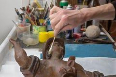 Restauração dos anjos - detalhe de mãos Fotografia de Stock Royalty Free