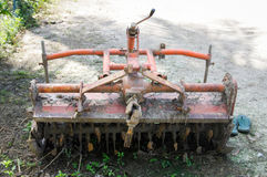 Rested rotary harrow plow. Detail of parking dirty rotary harrow plow Royalty Free Stock Photo
