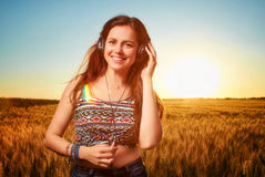 Rested young athletic woman with closed eyes,  listening to musi Royalty Free Stock Photo