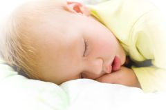 Restful baby boy sleeping on bed stock photos