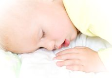 Restful baby boy sleeping on bed Royalty Free Stock Images