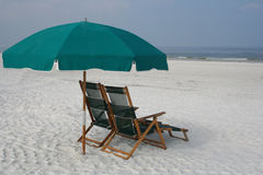 Restful beach. Parasol and chairs in a restful beach Royalty Free Stock Photos