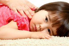 Restful child. Portrait of small girl relaxing with serene expression Royalty Free Stock Photo