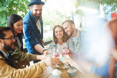 Restful company. Affectionate couple and friends enjoying get-together Royalty Free Stock Photography