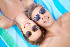 Restful couple. Attractive couple in eyeglasses enjoying summer vacations Royalty Free Stock Photos