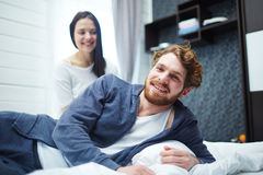 Restful couple. Cheerful men and his wife enjoying home rest Stock Images