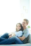 Restful couple. Young men and his girlfriend lying on sofa at home Royalty Free Stock Images