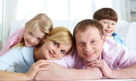 Restful family. Happy family relaxing at home on weekend Royalty Free Stock Image