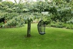 Restful garden. Swing in garden stock images