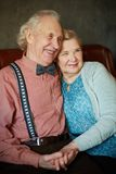 Restful seniors. Portrait of retired couple in smart clothes having rest Royalty Free Stock Photography