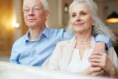 Restful seniors. Senior husband and wife sitting in cafe and having rest Stock Photography