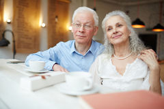 Restful seniors. Senior husband and wife spending time in cafe Royalty Free Stock Photos