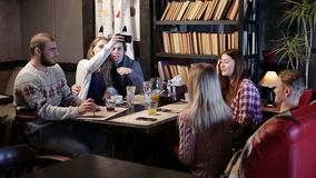 Restful teenage friends enjoying in the cafe. Stock Photos