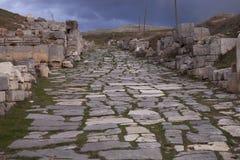 Resti della strada con Antioch Pisidian in Turchia Fotografie Stock Libere da Diritti