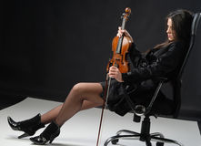 Resting. The girl with the violin is resting royalty free stock photo
