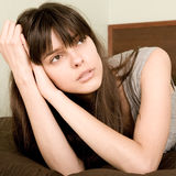 Resting. Yong beautiful woman resting on the sofa Royalty Free Stock Photography