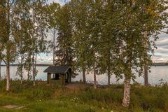 Resting area by a lake. Resting area at a roadside at a lake in northern Finland stock photo