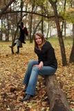 Resting in autumn park Stock Photo