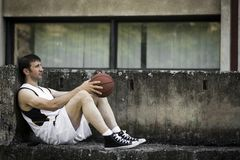 Resting basketball player Stock Images