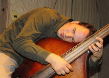 Resting Bass Player. Resting Double Bass Player Djordje of Fishtank Ensemble Taking a Breather royalty free stock images