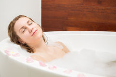 Resting in a bath. Young pretty tired woman resting in a bath Royalty Free Stock Photography