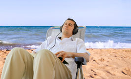 Resting at the beach with music Royalty Free Stock Images