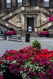 The Town House in Linlinthgow, Scotland, UK. Resting on the bench in front of a historical building, the Town House in Linlinthgow, Scotland, UK royalty free stock images