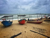 Resting boat monsoon season. Parked boat at Terengganu& x27;s beach during monsoon. Strong winds and rough seas make it difficult for the fishermen to the sea Royalty Free Stock Photography