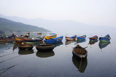 Resting boats. Some boats resting at a fishing village stock photography