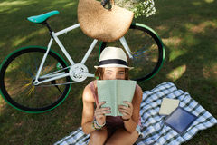 Resting with a book Royalty Free Stock Image