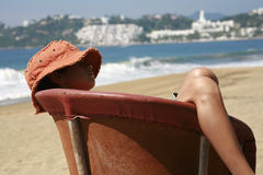 Resting breeze. Young boy resting over an equipal in a beach in mexico Stock Photos