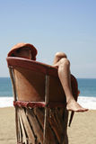 Resting breeze. Young boy resting over an equipal in a beach in mexico Stock Photography