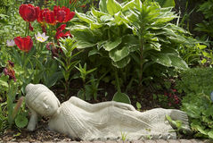Resting Buddha. This buddha really know how to relax. Find your peace in a garden of your own Stock Photo